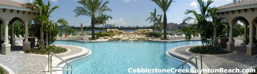 While away your weekend relaxing in the Florida sun at this resort-like pool area at Cobblestone Creek in Boynton Beach.